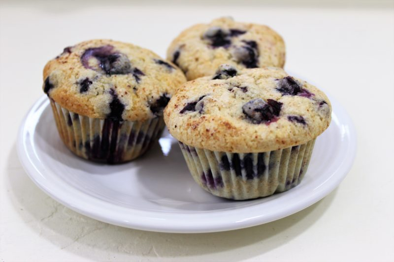 3 blueberry muffins on a plate