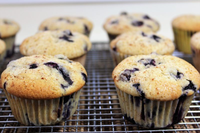 close up of cooling blueberry muffins