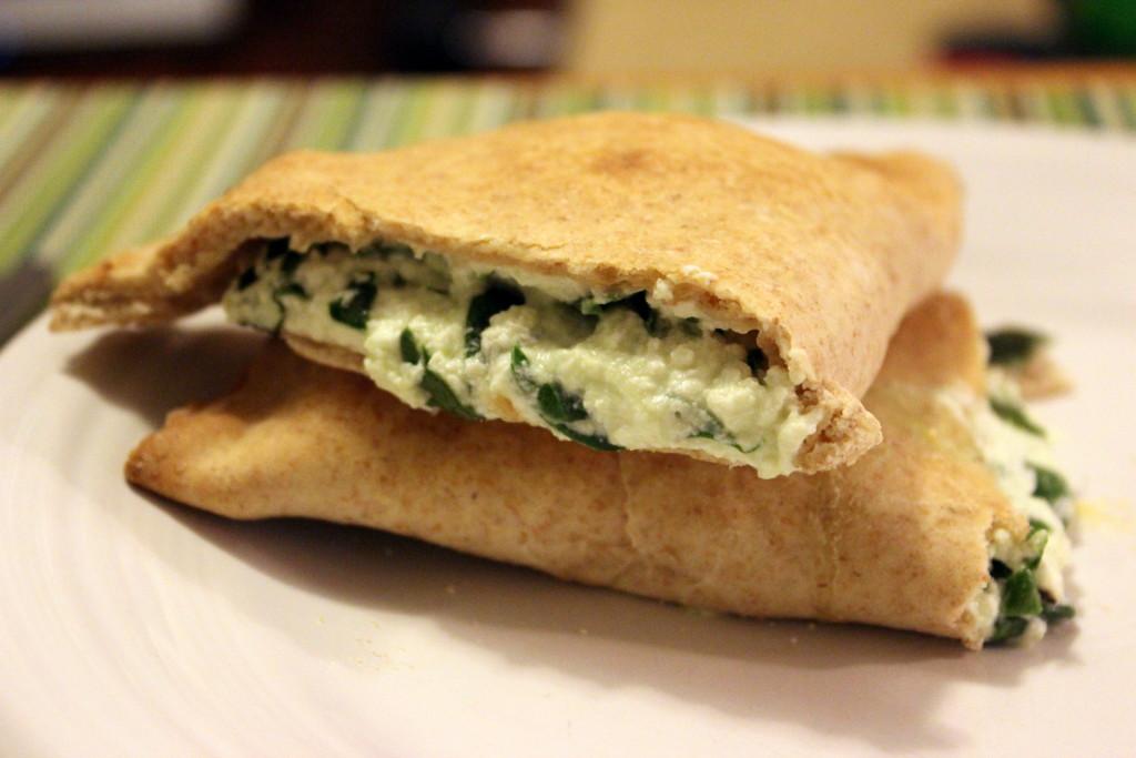 spinach calzone, cut in half