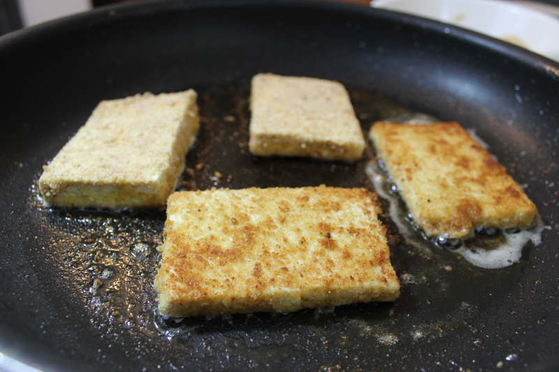 tofu Parmesan cooking in pan