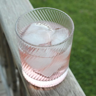 gin and tonic with strawberry shrub