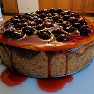 cheesecake with cherry topping, side view