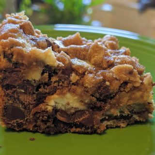 A Peanut Butter Chocolate Chip Cookie Cheesecake Bar